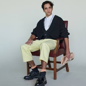 Prada cotton cardigan, £880, cotton shirt, £510, denim trousers, £545, cotton socks, £140, and leather shoes, £610. Cutler and Gross glasses, £295. Bunney hammered 925-silver signet ring, £360, from doverstreetmarket.com