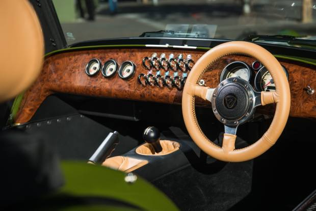The customised Seven 420S features a wooden, handcrafted dashboard and butterscotch leather interior