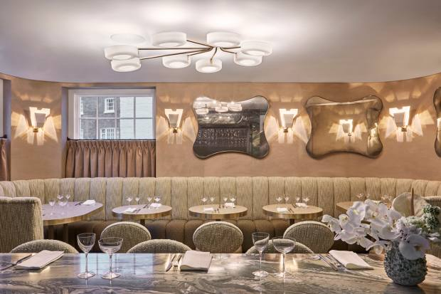 The intimate dining room, seating just 25 guests, has a laid-back luxe aesthetic