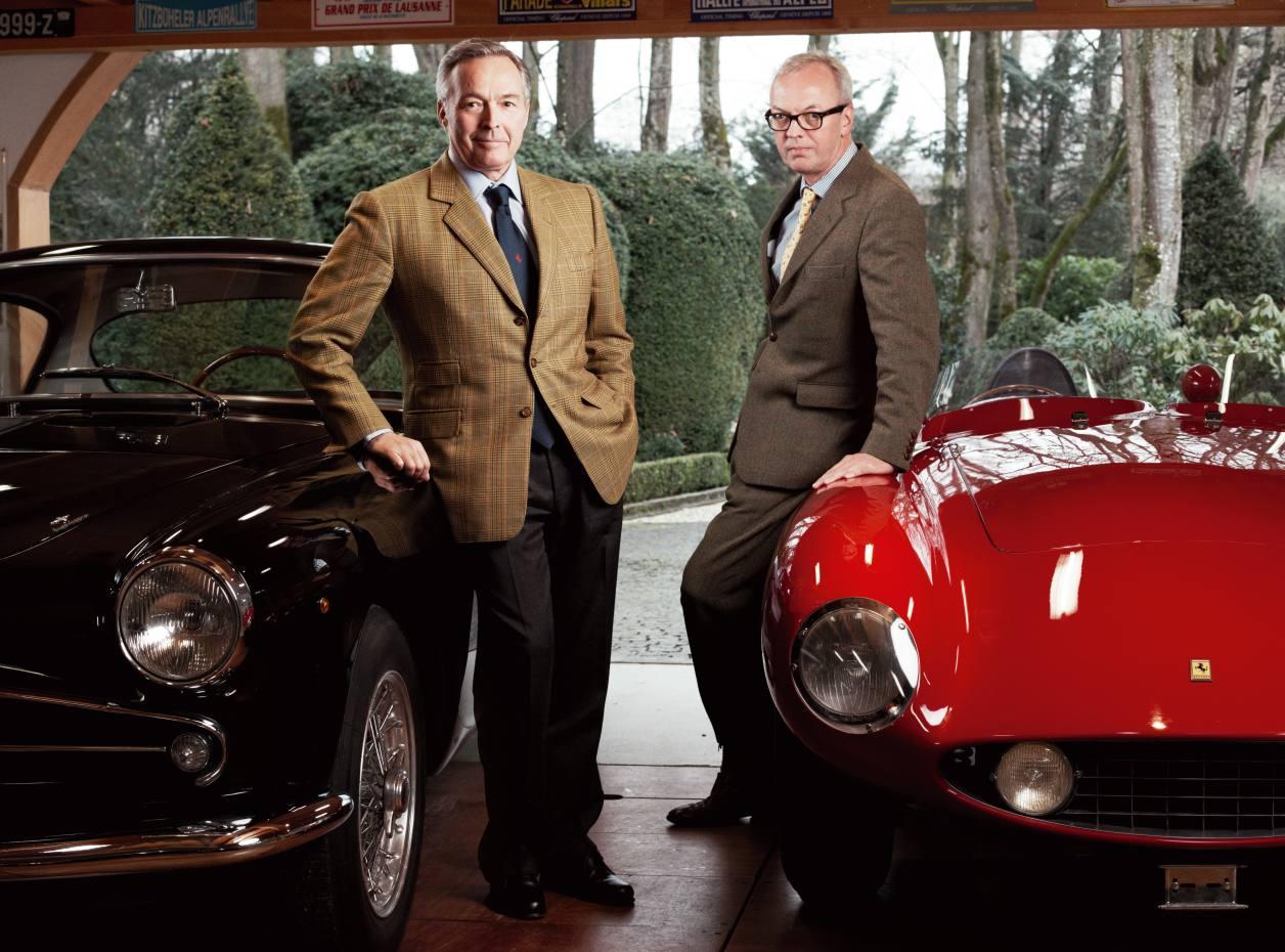 Karl-Friedrich Scheufele (left) and Peter Bradfield, with Scheufele's black 1956 Alfa Romeo 1900 CSS and red 1955 Ferrari 750 Monza