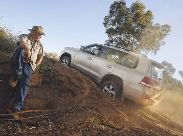 A Toyota Land Cruiser V8 makes easy work of a steep slope in the Australian Outback.