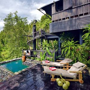 A Jacuzzi plunge pool and deck at Capella Ubud in Bali's verdant rainforest