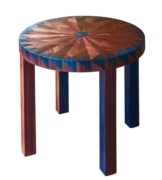 The straw on this table is tinted using dark fabric dyes