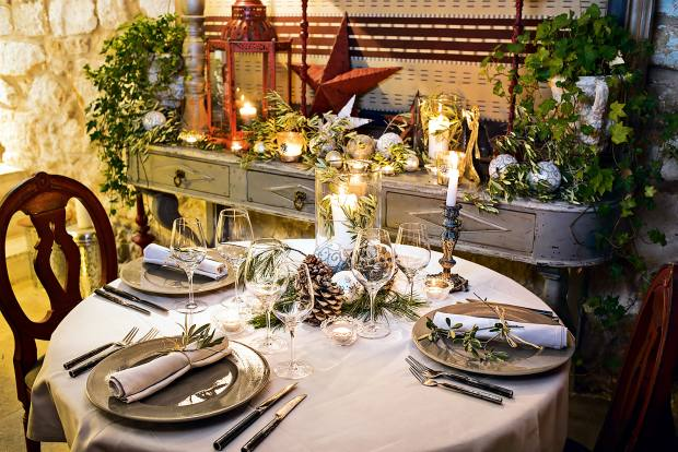 The candlelit dining room at La Bastide de Marie will host traditional Christmas suppers