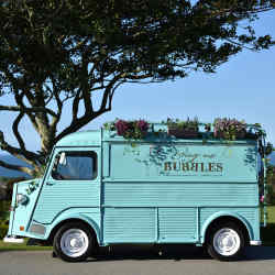 Many vendors, such as Bring Me Bubbles, house their mobile bars or food trucks inside beautiful vintage vehicles