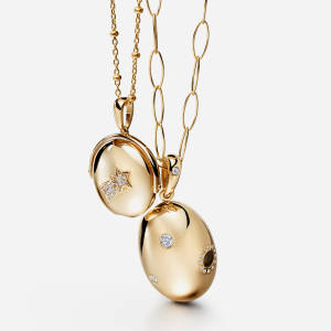 The new Lumiere collection is a series of 9-14ct goldpendants designed around a miniature lenshidden in the heart of each piece