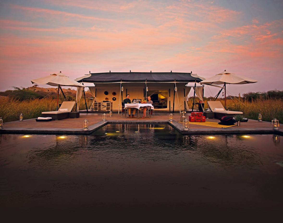 Guests enjoy a sunset supper outside Suján Jawai's Royal tented suite, Rajasthan