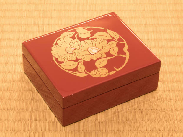 Ornamental red-lacquer boxes, about £220