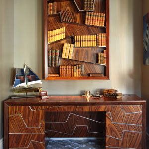 Pedestal desk in Santos rosewood and nickel by Gosling, £20,000-£25,000, and matching bookcase, £12,000-£15,000.