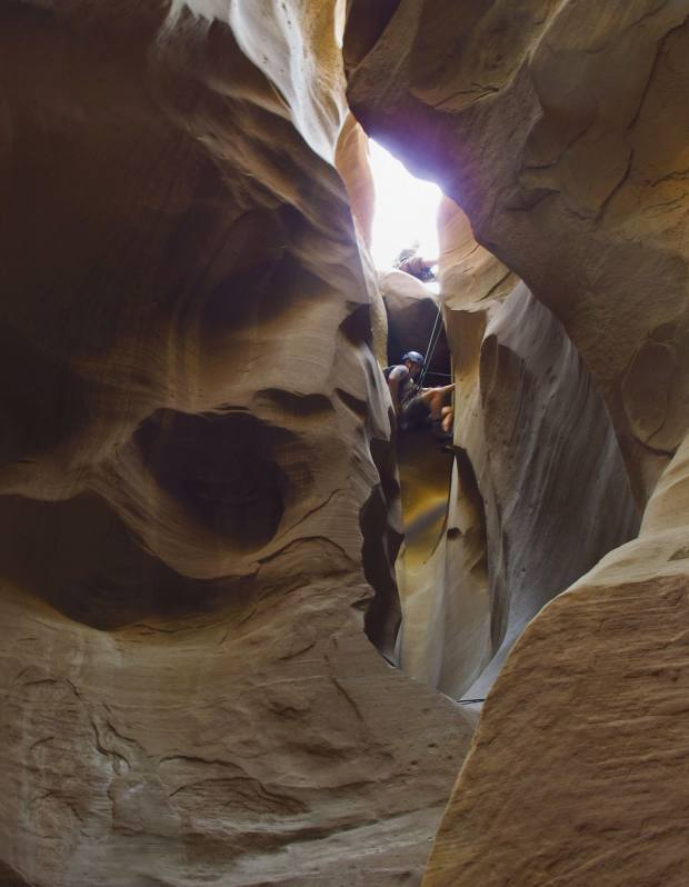 On an 80ft rappel in the Blue Pools slot canyon