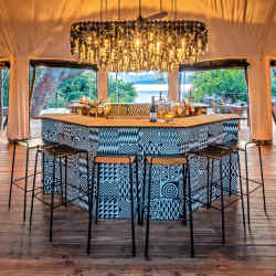 The airy tents at Wilderness Safari's Magashi, in Rwanda's Akagera National Park, look over Lake Rwanyakazinga – seen here are the camp's bar and dining spaces