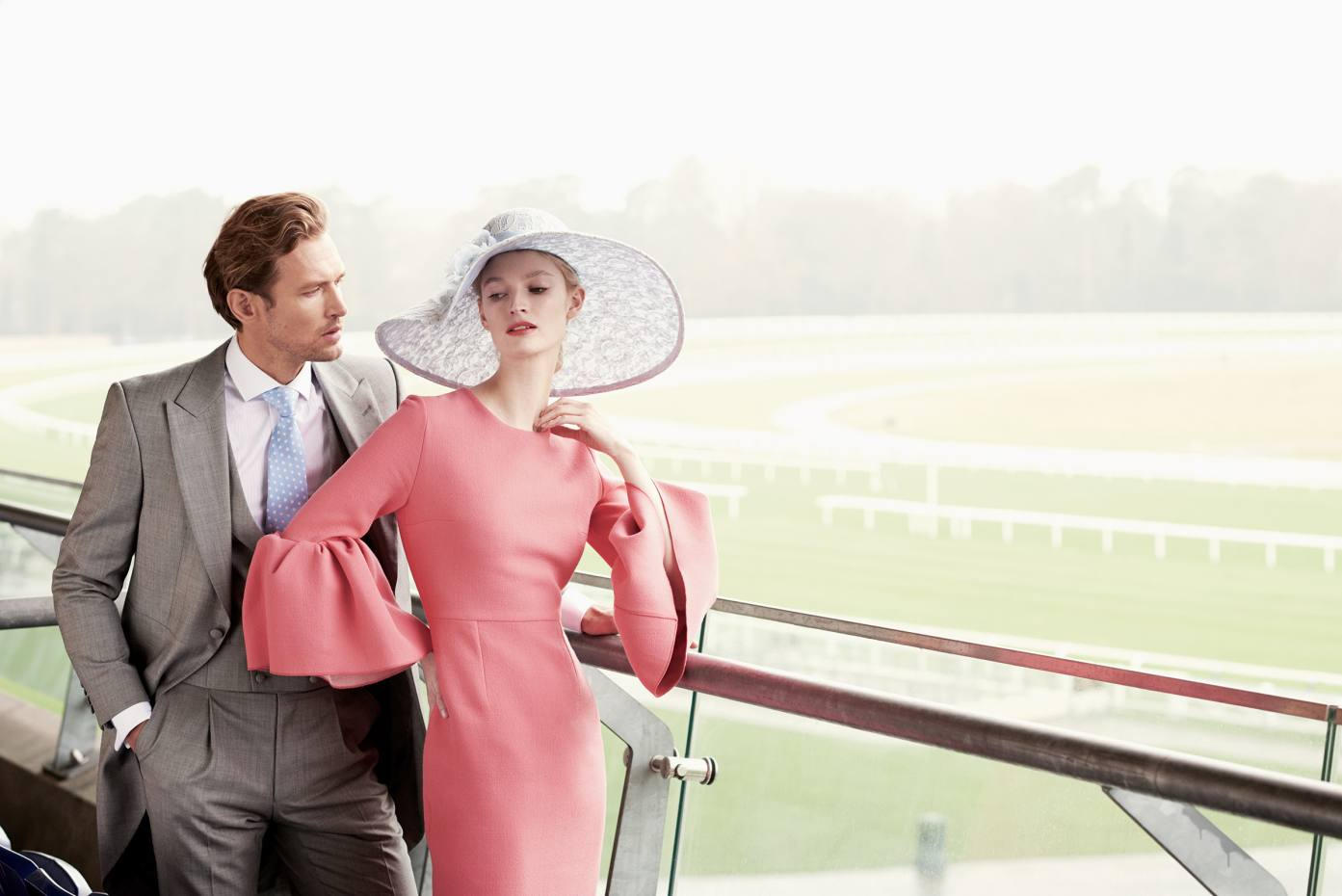 He wears Gieves & Hawkes wool morning suit, £1,100, and cotton shirt, £125. Oliver Brown silk twill tie, £35. She wears Roksanda polyester-mix Margot dress, £995. Edwina Ibbotson Millinery sinamay straw and lace Lace & Flowers hat, £1,460