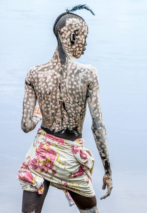 A Kara man painted for courtship, Omo Valley, 2013