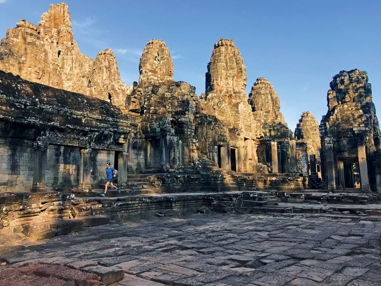The author explores the maze-like Bayontemple at the heart ofAngkor Thom, 7km into his40km Sunday run