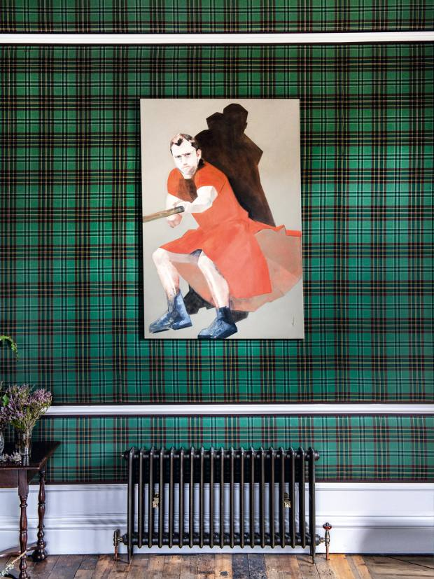 The walls of the drawing room are covered in The Fife Arms tartan by Araminta Campbell and feature Lifting VII by Stéphanie Vandem