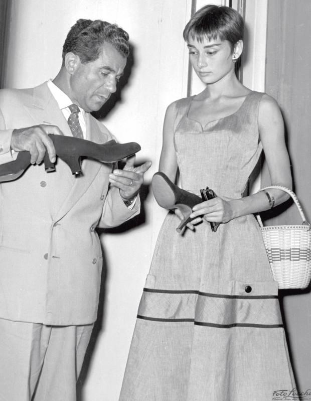 Salvatore Ferragamo with Audrey Hepburn at Palazzo Spini Feroni in Florence, in 1954