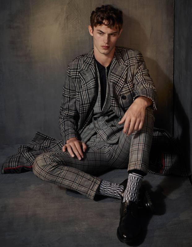 HUGO wool coat, £450, wool‑mix suit, £550, cotton jersey top, £99, and leather Derby shoes, £250. Burlington cotton/elastane-mix socks, £10