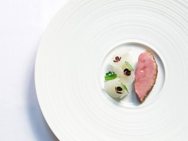 The menu includes a duck dish