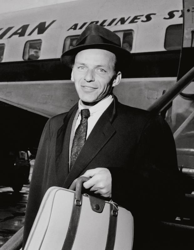 Frank Sinatra carrying a Serapian bag