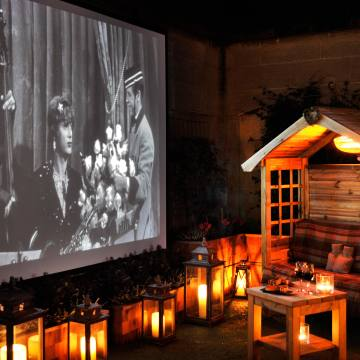 The cinema seats are set within private log cabins on The Berkeley's rooftop terrace