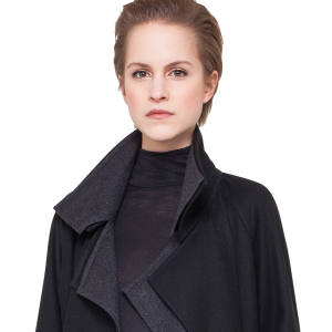 Akris cashmere coat, £3,566, cashmere/silk-jersey polo neck, £592, and wool trousers, £592.