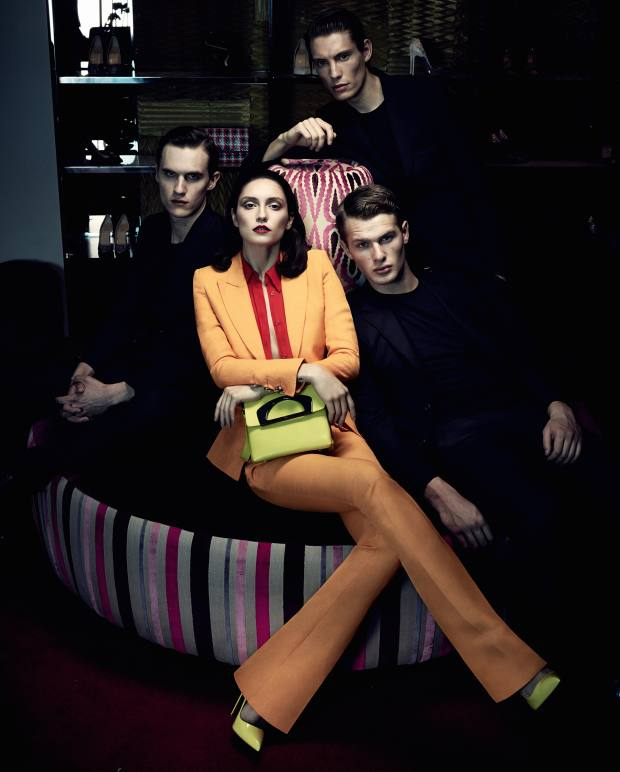 Anna wears Emilio Pucci linen mix fitted jacket, £1,295, matching trousers, £550, and silk shirt, £640. Christian Louboutin patent leather Iriza heels, £425, and calfskin Passage Mini bag, £1,095. From near right: Luka wears Billionaire wool jacket, £1,395, and cotton trousers with leather details, £455. Sunspel Egyptian cotton T-shirt, £55. Kai wears Gucci wool suit, £1,840. James Perse cotton T-shirt, £50. Vincent wears Burberry wool/cashmere suit, £895. Orlebar Brown cotton T-shirt, £60
