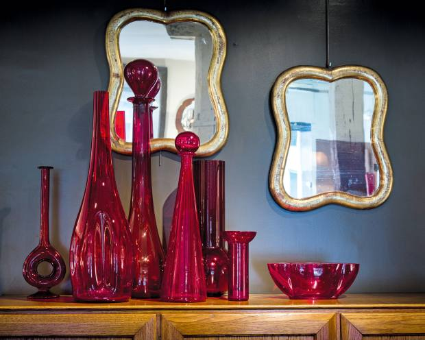 A collection of seven different-sized red glass vases from the 1960s, €4,295
