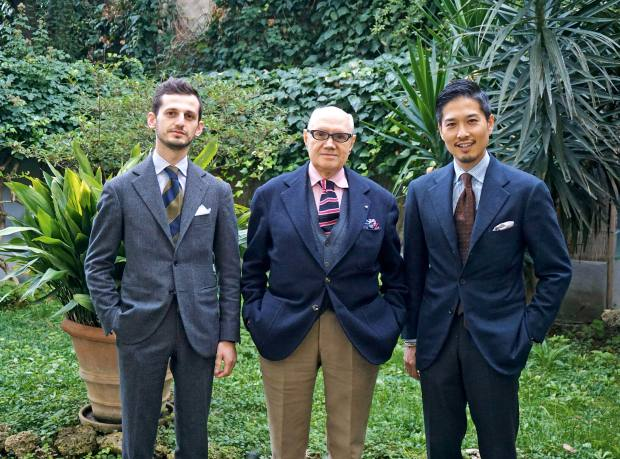 Neapolitan tailor Antonio Liverano (centre) with members of his team at Liverano & Liverano, all wearing the company's bespoke tailoring, suits from €5,460
