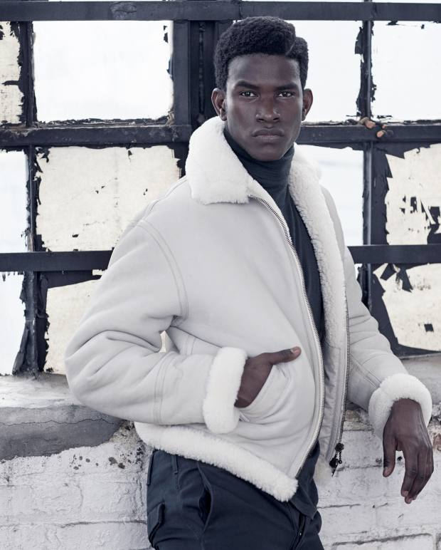 Balenciaga shearling bomber jacket, about £2,800, and cotton gabardine trousers, about £400. Hermès extra-fine cashmere rollneck, £1,100