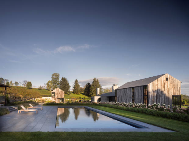 A home in upstate New York designed to nestle unobtrusively within the surrounding farmland
