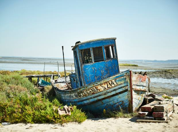 An old boat in the 200-year-old fishing village of Carrasqueira