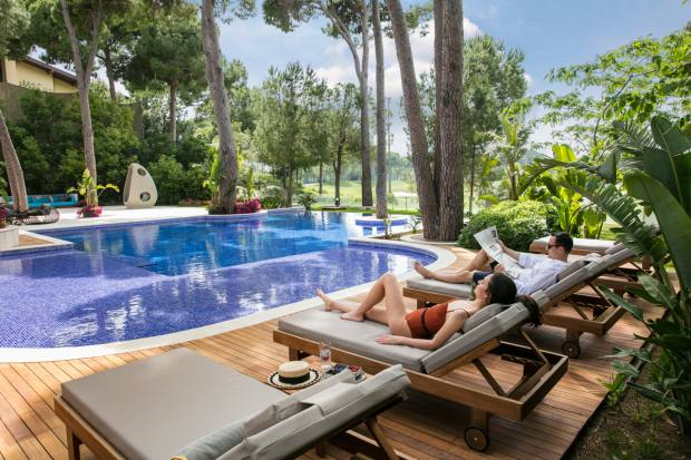 Relax by the pool at Maxx Royal Belek