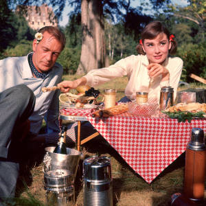 Gary Cooper and Audrey Hepburn on the set of Love in the Afternoon, 1957