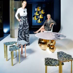 Garance Primat-Schlumberger, left, with Béatrice Saint-Laurent at Galerie BSL in Paris. Clockwise from top left: Faye Toogood brass, rubber, steel and stone Caged Elements chair, price on request; Charles Kalpakian Cinétisme I lacquered-wood wall cabinet, €12,000; Studio MVW jade and anodised-brass JinShi coffee table, €42,000; set of five Taher Chemirik sodalite and copper-plated-brass side tables, €48,000