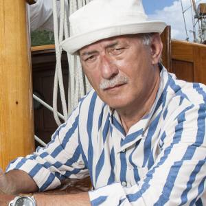 Angelo Bonati on Bermudian ketch Eilean outside English Harbour