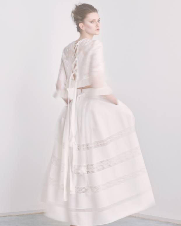 Alberta Ferretti polyester-mix mesh jacquard top, £810, andcotton skirt, £770. SimoneRocha single Perspex earring, £330
