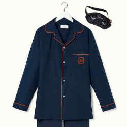From left: The Mark pyjamas with smart orange piping, $400. Black silk sleeping mask with white eyelash graphics, $30