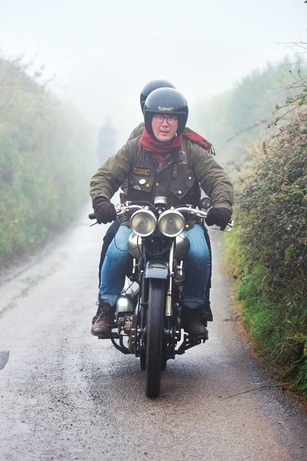 Mark Upham, owner of Brough Superior Motorcycles, rides to Cornwall on a 1927 SS100 Brough Superior, with his daughter riding pillion