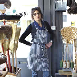 Martha Tiffin in her Brighton hardware and household shop, Utility.