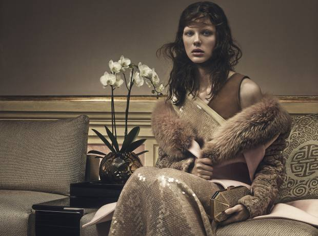 Givenchy by Riccardo Tisci wool coat with mink and fox-fur collar, about £7,132. Jonathan Saunders sequinned- jersey dress, £1,890. Stark 24ct-gold-plated clutch bag, £1,140  Fendi Casa silk-canvas sofa, from £4,120; silk-jacquard cushion, price on request; Macassar-ebony coffee table, from £2,880; and handmade Murano-glass vase, £2,200