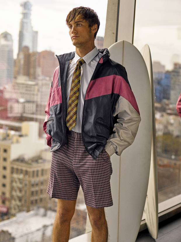 Fendi leather jacket, £3,035, cotton shirt, £250, cotton-mix Bermuda shorts, £325, and silk tie, £115. Saturdays NYC surfboard, price on request