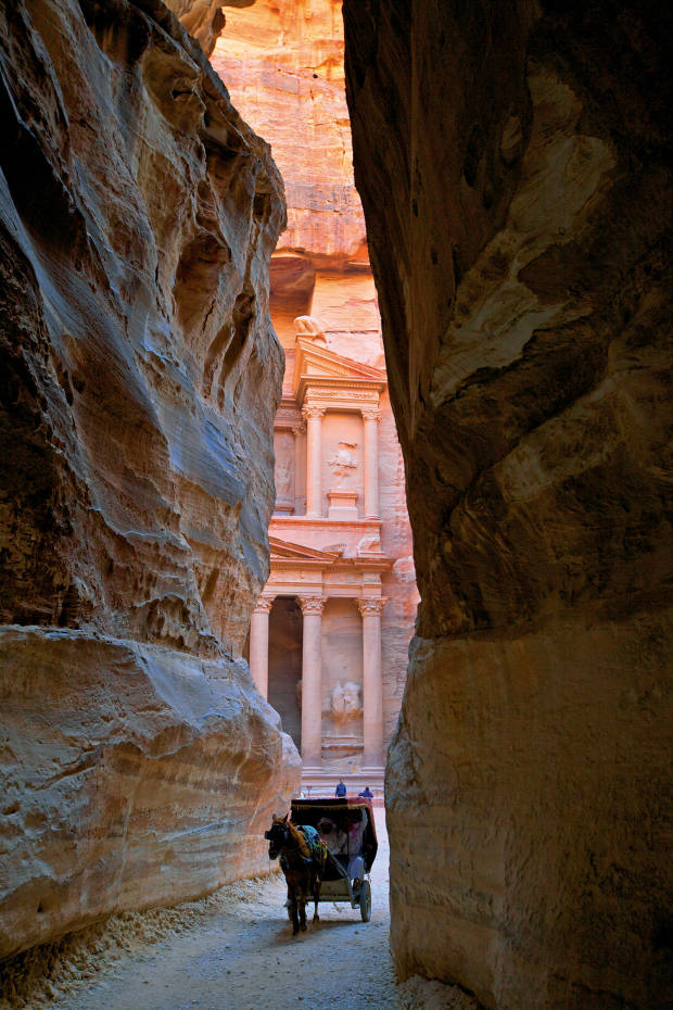The 2,100-year-old sandstone city of Petra is reached via the kilometre-long fissure in the mountains called theSiq