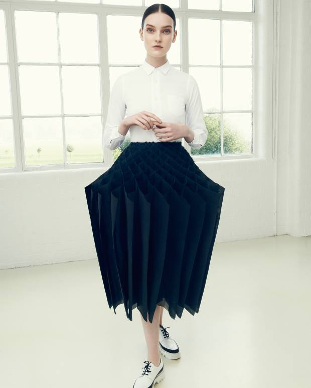 Junya Watanabe cotton blouse, £190, and polyester pleated skirt, £1,330. Walter Steiger leather shoes, about £435