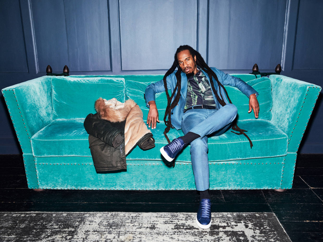 Benjamin Zephaniah, one of the UK's most celebrated vegans, wears Brave GentleMan double-breasted suit, $2,500, produced from 9oz Italian-milled bamboo with tagua nut buttons; organic-cotton shirt, $245. Noani eucalyptus-fibre/recycled polyester Bigbuc belt, €69.95. Boss limited-edition, pineapple-leaf-fibre Piñatex sneakers, £219. Beside him, HoodLamb Nordic Parka, €499, lined in Satifur and packed with Thermore Ecodown, both manufactured from recycled plastic bottles
