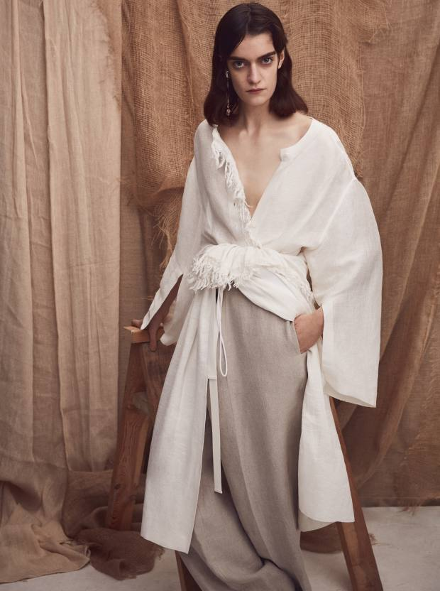 Joseph linen Billy shirt, £495, and matching Cammy skirt (wrapped around waist), £495. Victoria Beckham cotton trousers, £725. Slim Barrett silver, crystal and glass earring, £550