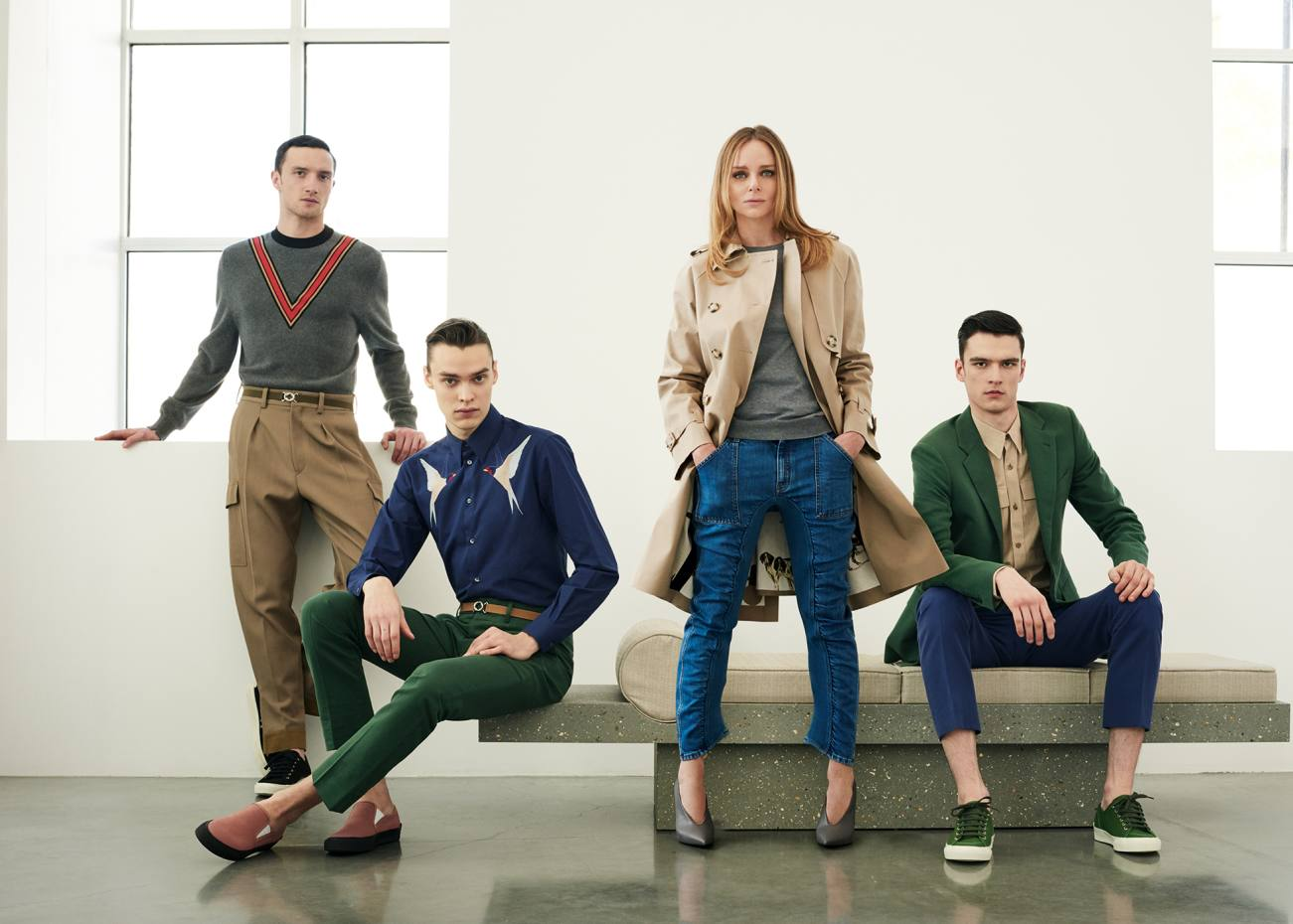 Stella McCartney with models wearing items from her debut menswear collection. From left: cotton jumper, £570, cotton trousers, £320, canvas trainers, £315, and elastic belt, £180; cotton shirt, £485, cotton trousers, £325, canvas shoes, £290,and elastic belt, £180; and cotton jacket, £840, cotton shirt, £345, cotton trousers, £325, and canvas trainers, £315