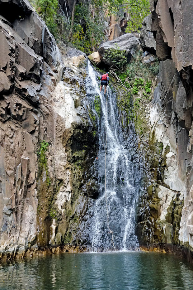 Guide Paul Teasdale abseils down a waterfall during the descent of Dibu Dibu canyon