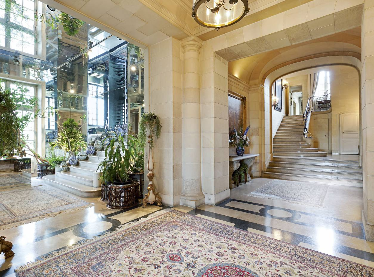 The entrance gallery and marble staircase of a two-floor apartment on the Quai d'Orsay, on sale for €42m with Belles Demeures de France Fine Residences.