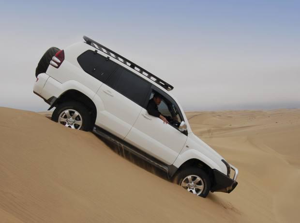 The Toyota Land Cruiser descending a dune near to Swakopmund