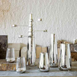 From far left: E&Co x Christopher Jenner silver-plated Bounce Crystal votives, £280 each, silver‑plated Kinetic Monolith candelabra, £2,200, and small, tall and medium silver-plated Beacon candlesticks, £380, £450 and £300